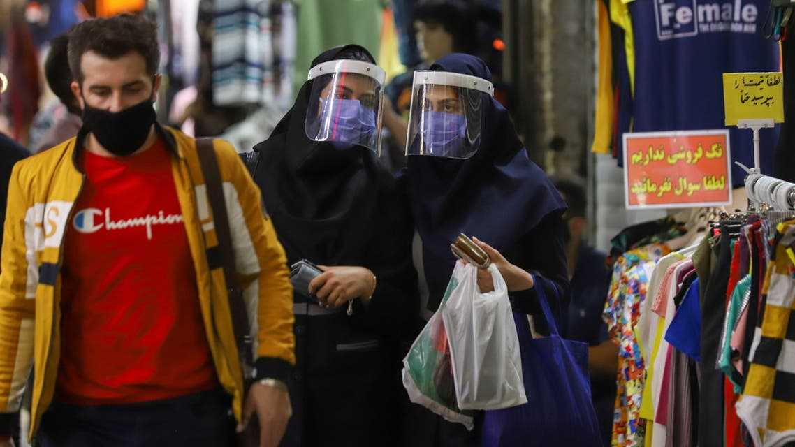 Iranian women wear protective face shields and masks as they walk in Tehran Bazaar in Tehran, Iran April 6, 2021. Majid Asgaripour/WANA (West Asia News Agency) via REUTERS ATTENTION EDITORS - THIS IMAGE HAS BEEN SUPPLIED BY A THIRD PARTY.