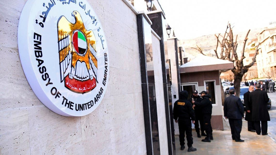 Officials and journalists gather outside the embassy of the United Arab Emirates, in Damascus, Syria, Dec. 27, 2018. (AP)