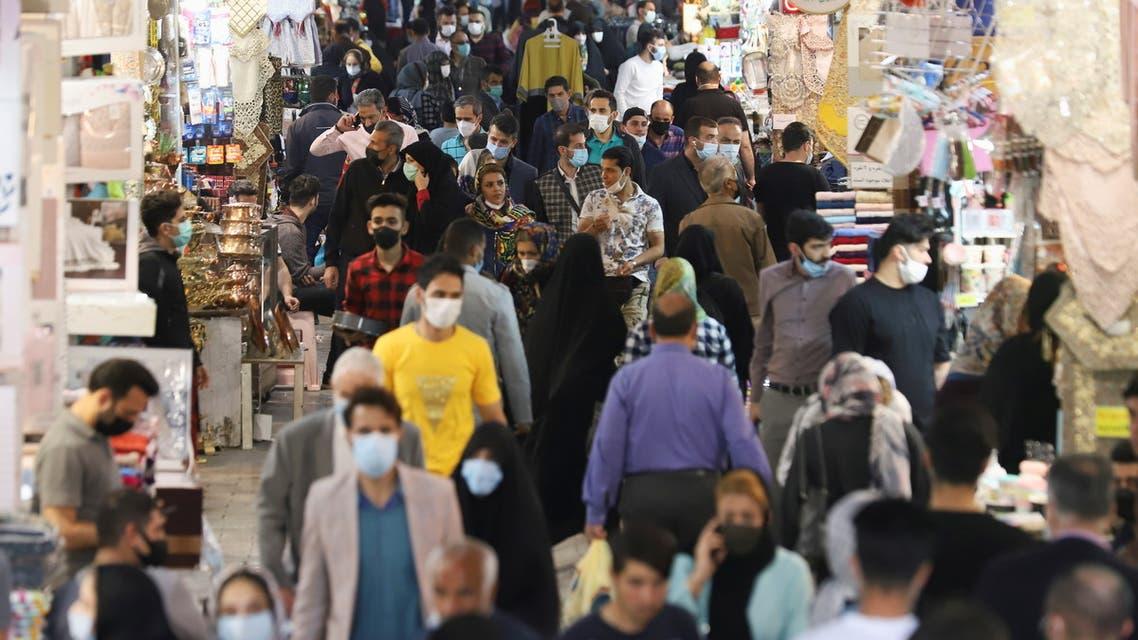 Iranian people walk in Tehran Bazaar, in Tehran, Iran April 6, 2021. (West Asia News Agency via Reuters)