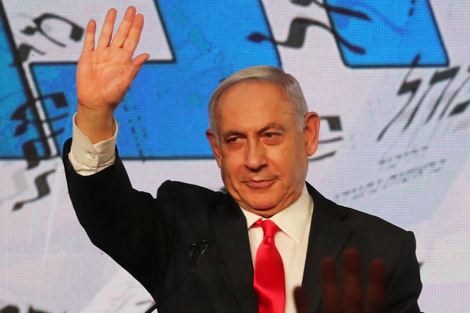 Israeli Prime Minister Benjamin Netanyahu gestures as he delivers a speech to supporters following the announcement of exit polls in Israel's general election at his Likud party headquarters in Jerusalem March 24, 2021. (Reuters)