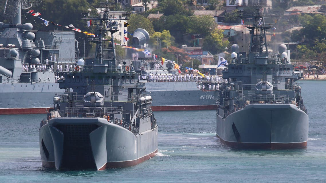 Russian armoured personnel carriers submerge from amphibious assault ships during the Navy Day parade in the Black Sea port of Sevastopol, Crimea July 26, 2020. (Reuters)