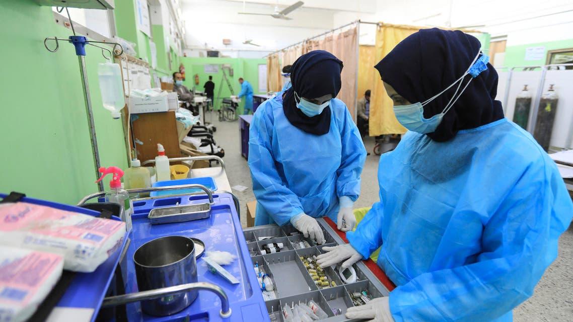 Palestinian medics work at the COVID-19 intensive care unit of al-Shifa Hospital in Gaza City on April 7, 2021.