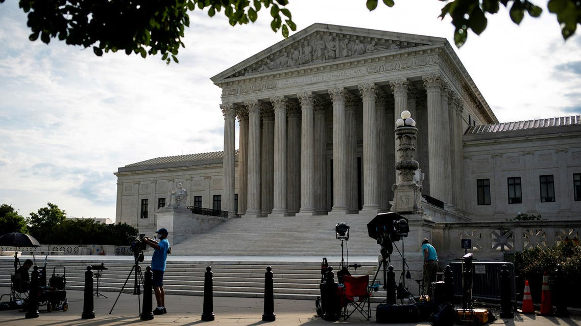FILE PHOTO: Members of the media set up in front of the U.S. Supreme Court building in Washington, U.S., June 25, 2020. REUTERS/Al Drago/File Photo