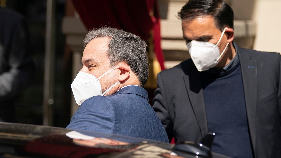 Political deputy at the Ministry of Foreign Affairs of Iran, Abbas Araghchi, left, leaves the 'Grand Hotel Wien' in Vienna, Austria, Friday, April 9, 2021 where closed-door nuclear talks with Iran take place. (AP)