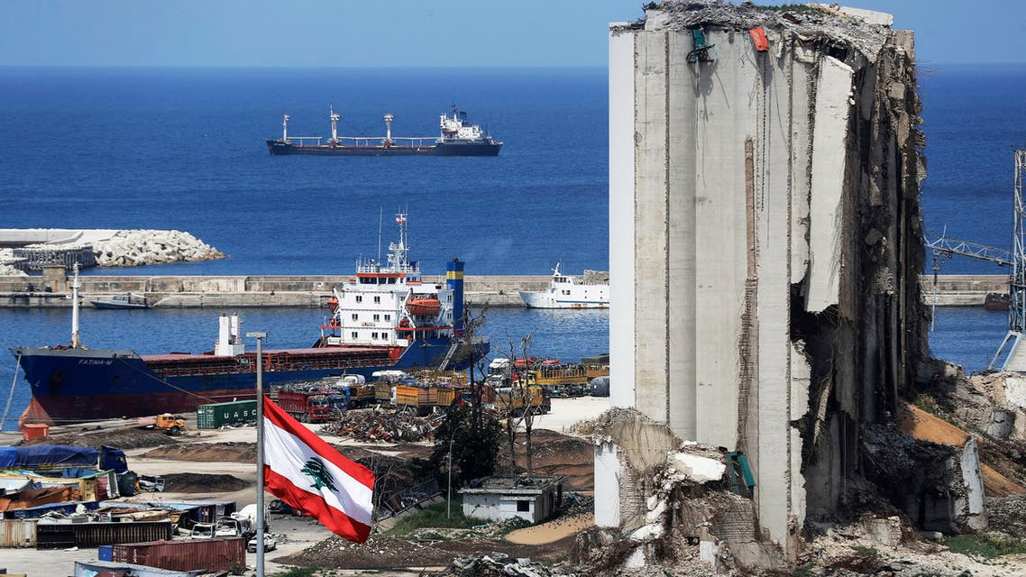 A picture shows a view of the damaged grain silos at the port of the Lebanese capital Beirut, on April 9, 2021, still reeling from the destruction due to a catastrophic blast in a harbour storage unit last August that killed more than 200 people and damaged swathes of the capital.