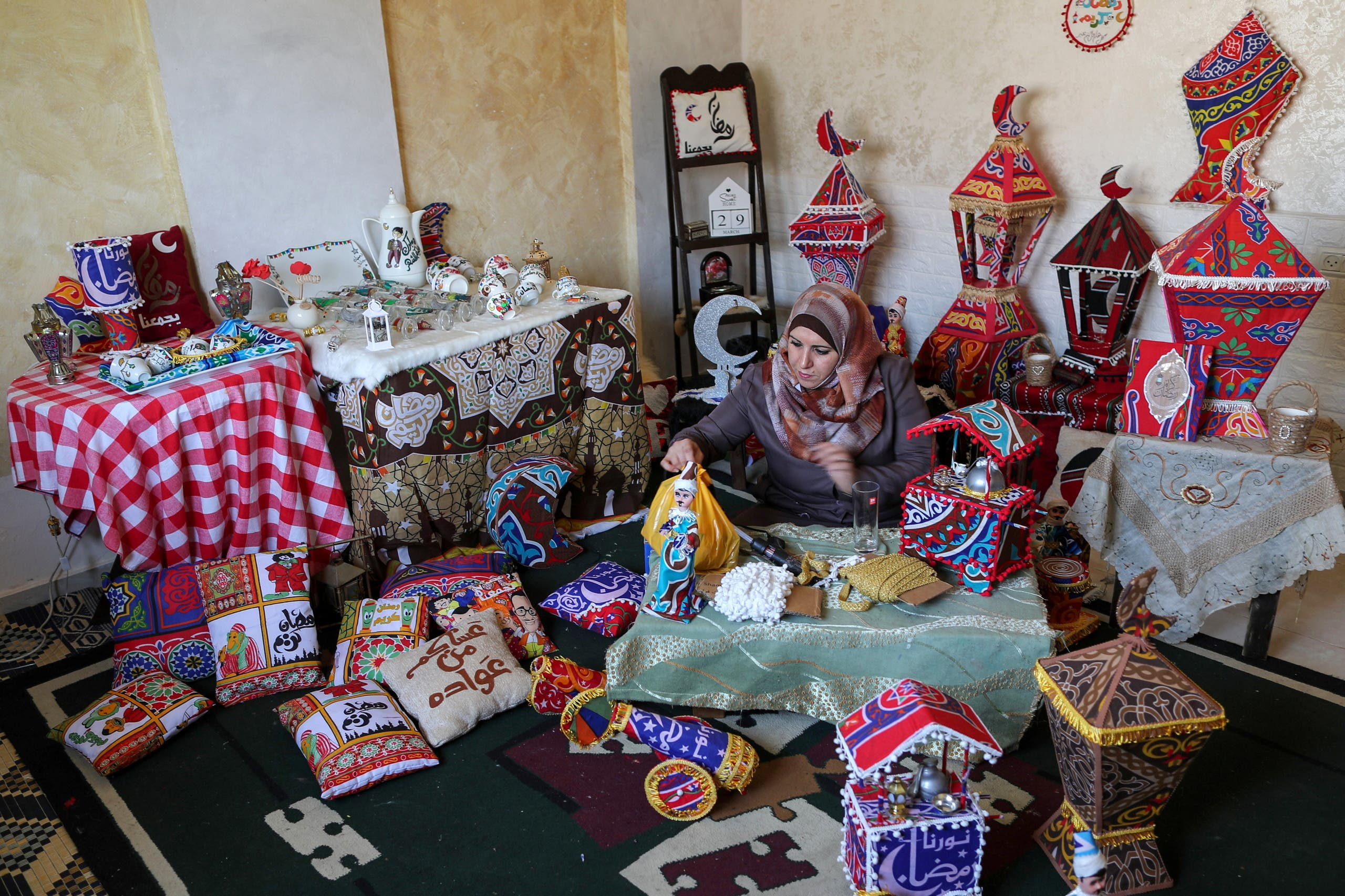 Palestinian Hanan Al-Madhoon makes decorations for sale ahead of the holy fasting month of Ramadan, at Beach refugee camp in Gaza City. (Reuters)