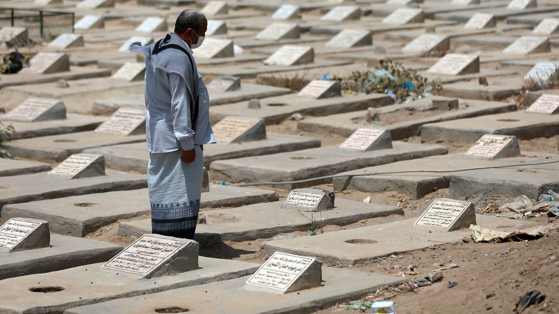 A Yemeni man visits the graves of loved ones close to a specific plot allocated to Covid-19 victims at a cemetery in Yemen's third city of Taez on April 3, 2021, amid a surge in cases of coronavirus that the war-torn country is badly equipped to combat. Between the mountain ranges of Taez, dozens of fresh graves are being hastily dug in Yemen's third city to deal with a spike in deaths from Covid-linked complications.