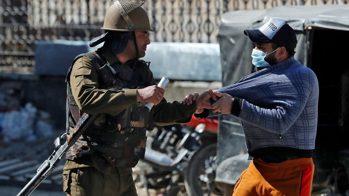 An Indian police officer detains a demonstrator during a protest after Friday prayers in Srinagar on March 5, 2021. (Reuters)