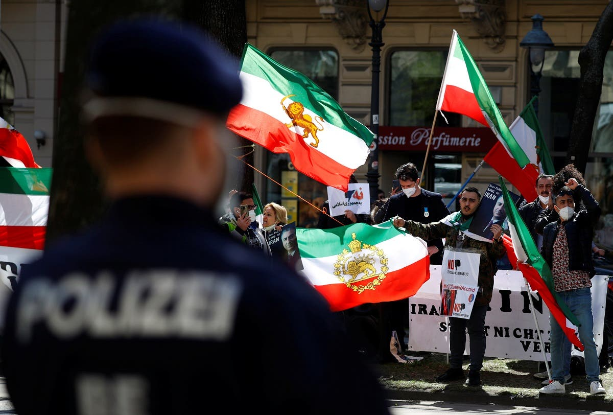 An Iranian opposition group protests outside a hotel, during a meeting of the JCPOA Joint Commission, in Vienna, Austria, April 9, 2021. (Reuters)