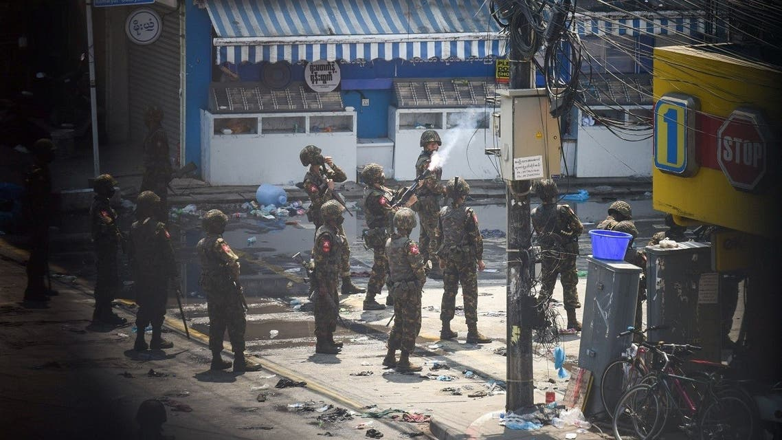 Army officers intervene during a protest against the military coup in Yangon, Myanmar, March 2, 2021. (Reuters)