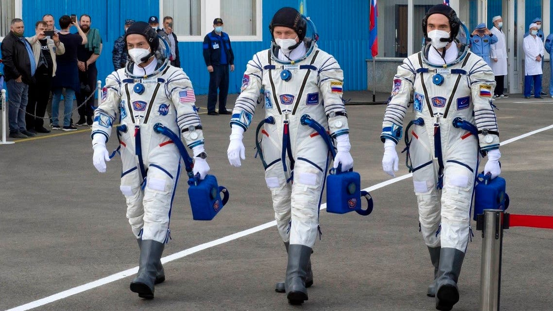 From left: US astronaut Mark Vande Hei, Russian cosmonauts Oleg Novitsky and Pyotr Dubrov, members of the main crew to the International Space Station (ISS), walk prior to the launch at the Russian leased Baikonur cosmodrome, Kazakhstan, on April 9, 2021. (AP)