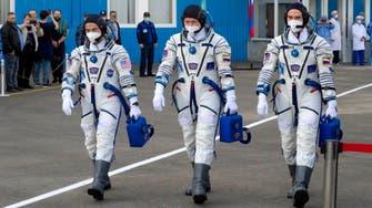 American astronaut, Russian cosmonauts dock at International Space Station