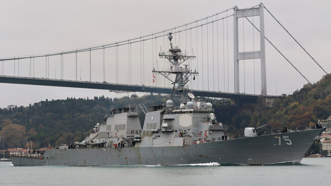 The U.S. Navy Arleigh Burke-class guided-missile destroyer USS Donald Cook (DDG 75) sets sail in the Bosphorus, on its way to the Black Sea, in Istanbul, Turkey December 2, 2020. Picture taken December 2, 2020. REUTERS/Yoruk Isik