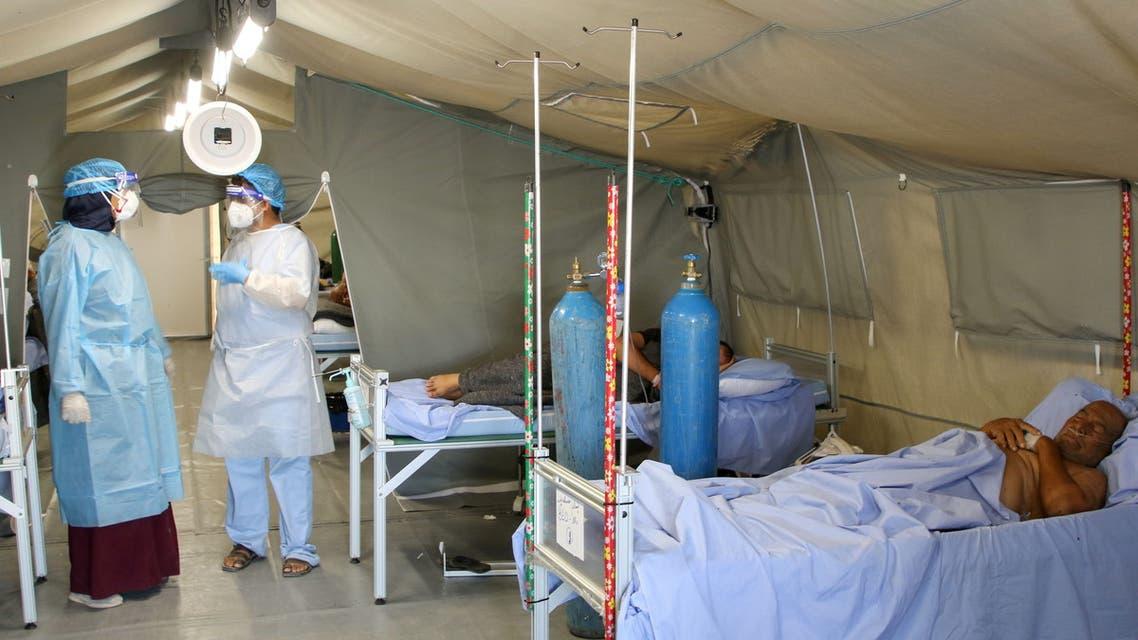 A man lies on a bed at a coronavirus disease (COVID-19) quarantine center in Aden, Yemen March 27, 2021. Picture taken March 27, 2021. REUTERS/Fawaz Salman