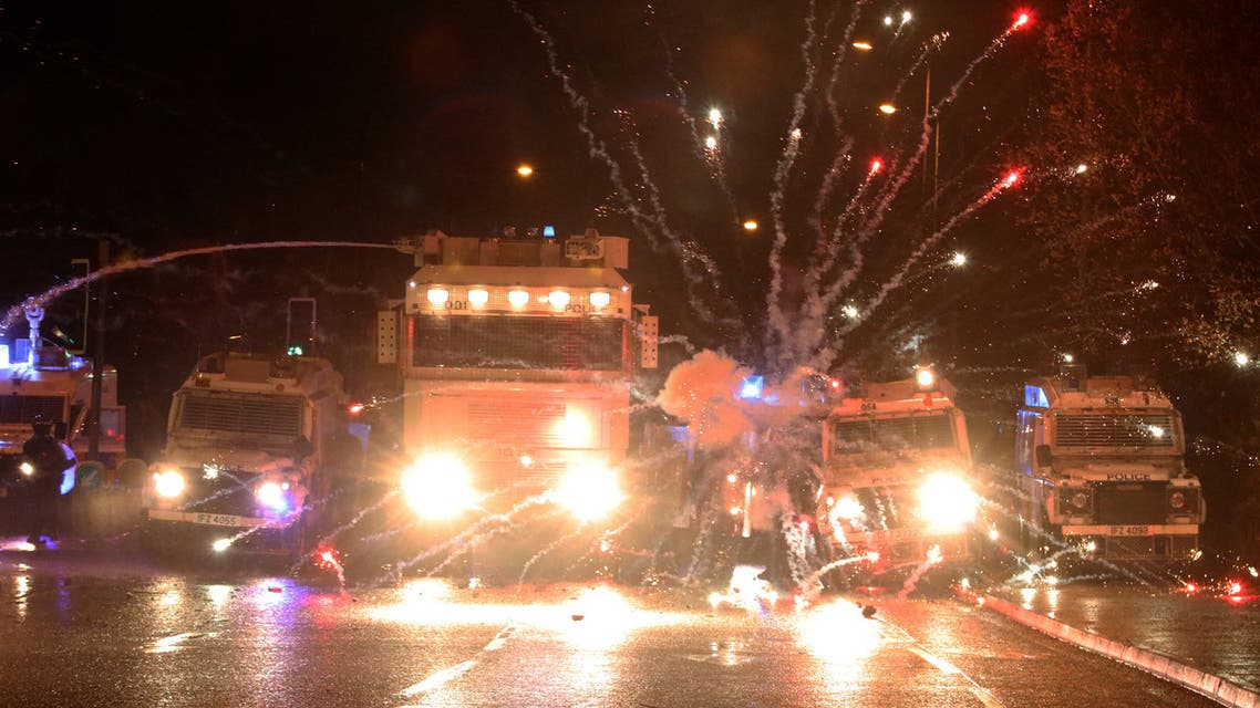 Fireworks explode at police vehicles after being fired at police officers with a water cannon during clashes with nationalist youths in the Springfield Road area of Belfast on April 8, 2021 as disorder continued in the Northern Ireland capital following days of mainly loyalist violence. Northern Ireland police faced a barrage of petrol bombs and rocks on on April 8, an AFP journalist said, as violence once again flared on the republican side of the divided city Belfast despite pleas for calm. Rioting over the last few days -- the city's worst unrest in recent years -- had mainly stemmed from its unionist community, who are angry over apparent economic dislocation due to Brexit and existing tensions with pro-Irish nationalist communities.