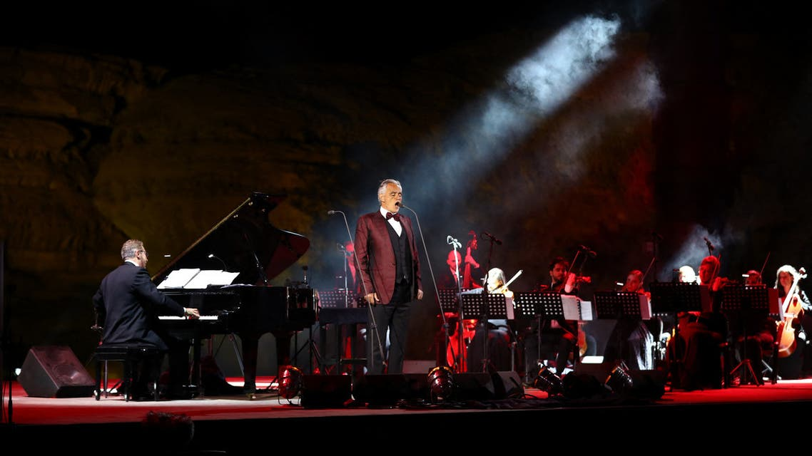 Italian tenor and opera singer Andrea Bocelli singing during a concert at the Hegra World Heritage Site in the northwestern Saudi city of al-Ula on April 8, 2021. (AFP)