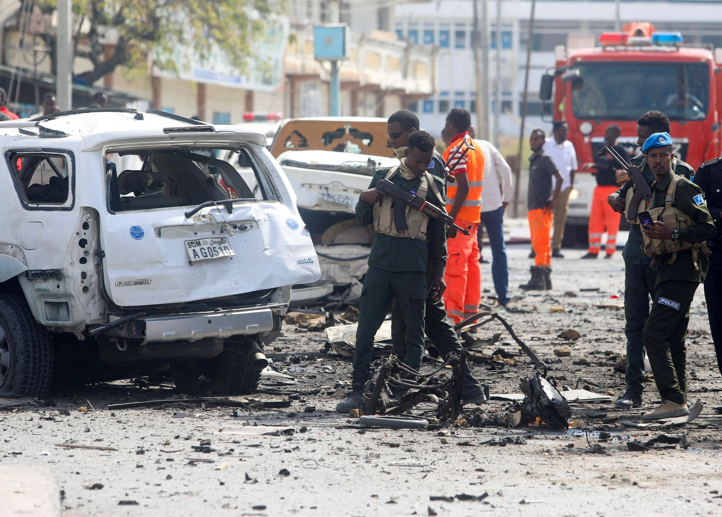 Somali security officers assess the scene of an explosion in Mogadishu, Somalia February 13, 2021. (Reuters)
