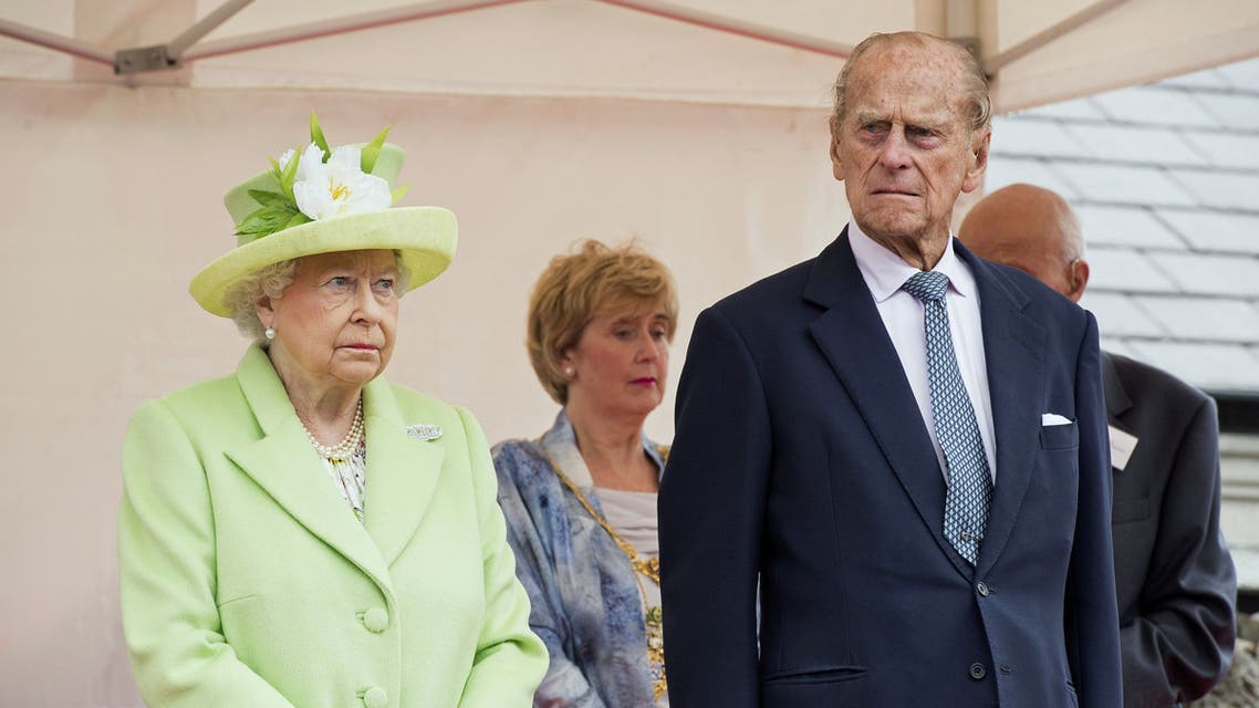 FILE PHOTO: Queen Elizabeth II and Prince Philip, Duke Of Edinburgh attend the unveiling of the Robert Quigg VC memorial statue in Bushmills village, Northern Ireland, June 28, 2016. REUTERS/Carrie Davenport/Pool/File Photo