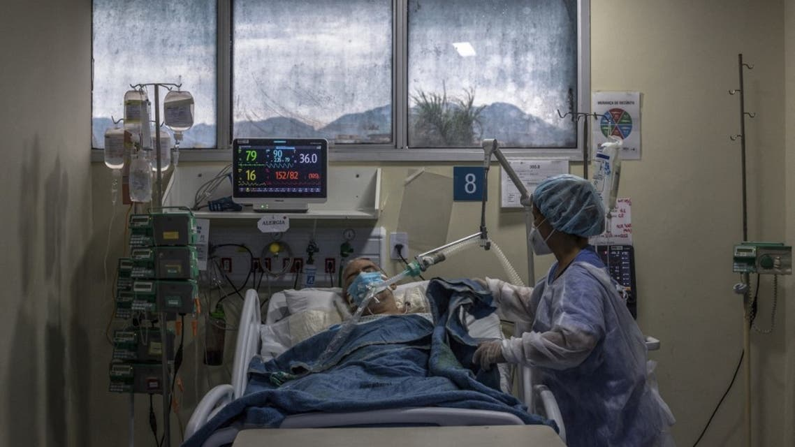 A health worker cares for a COVID-19 patient at an Intensive Care Unit (ICU) of the Ronaldo Gazolla Public Municipal Hospital in Rio de Janeiro, Brazil, on March 5, 2021. (AFP)