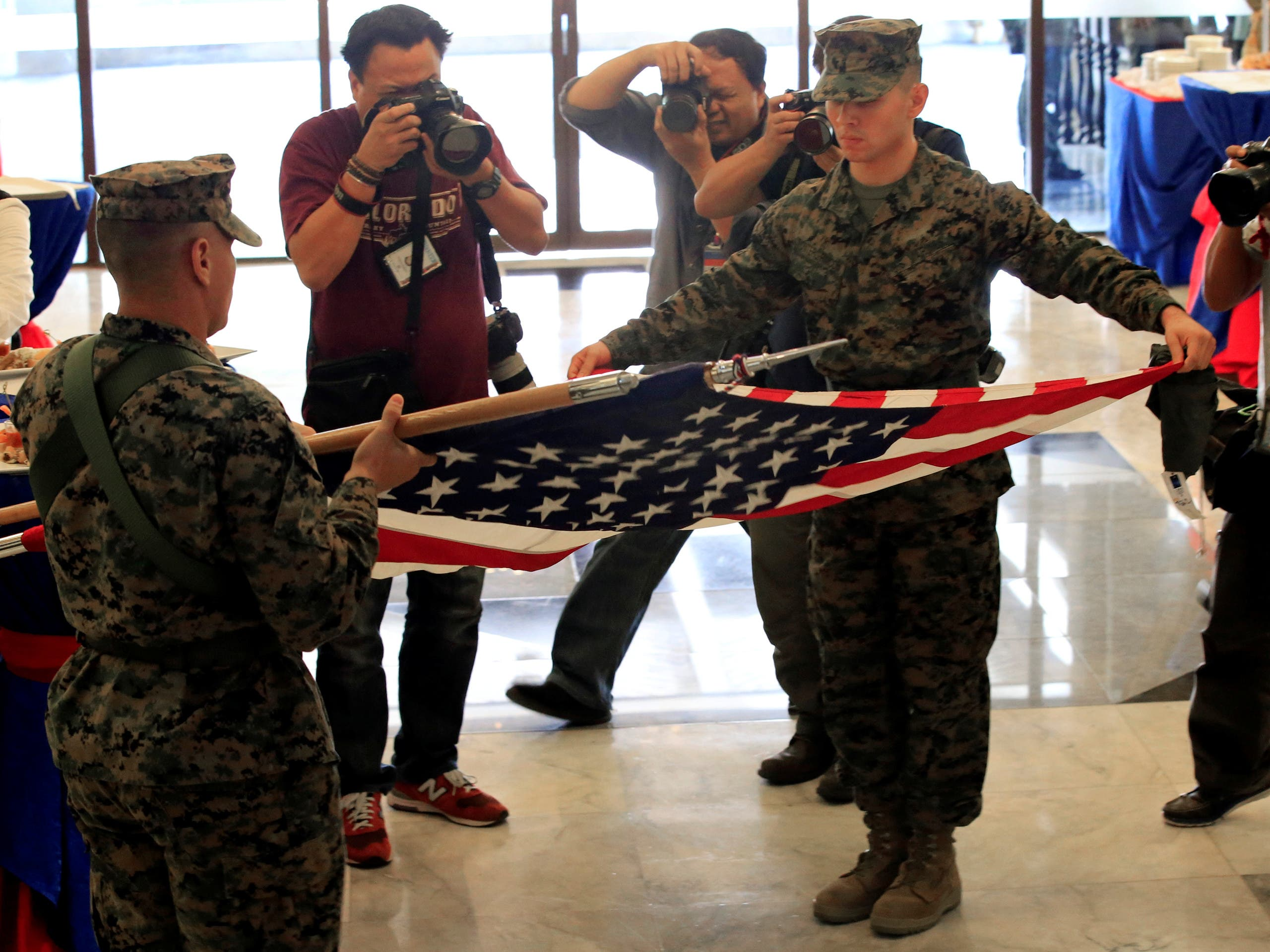 US soldiers furl the American flag during the closing ceremony of Philippines and US military joint exercises called Balikatan (Shoulder to Shoulder) at Camp Aguinaldo in Quezon city, Metro Manila, Philippines May 19, 2017. (Reuters)