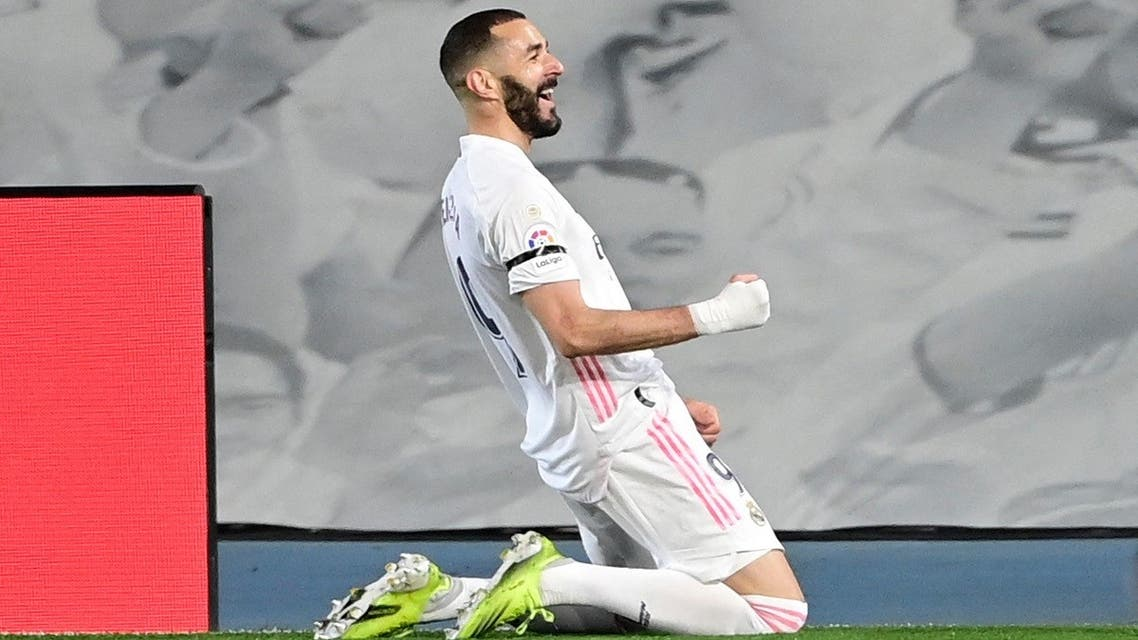 Real Madrid's French forward Karim Benzema celebrates after scoring during the El Clasico Spanish League football match between Real Madrid CF and FC Barcelona at the Alfredo di Stefano stadium in Valdebebas, on the outskirts of Madrid on April 10, 2021. (AFP)