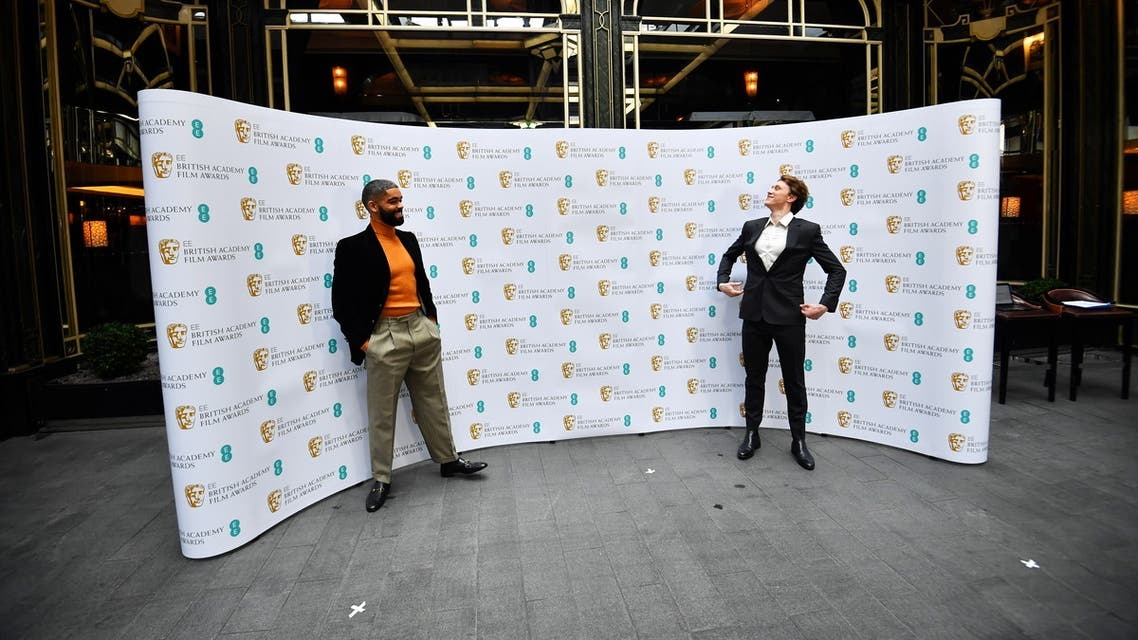 British actor Kingsley Ben-Adir shares a light moment with previous nominee George MacKay as he celebrates being nominated for the 2021 EE Rising Star Award, ahead of the BAFTA Film awards, during a media event at a hotel in central London, Britain March 3, 2021. (Reuters)