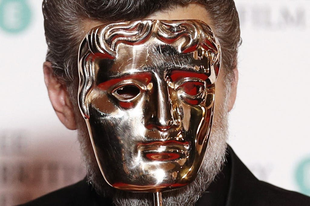 British actor Andy Serkis poses with the award for Outstanding Contribution to British Film at the BAFTA British Academy Film Awards at the Royal Albert Hall in London on February 2, 2020. (AFP)