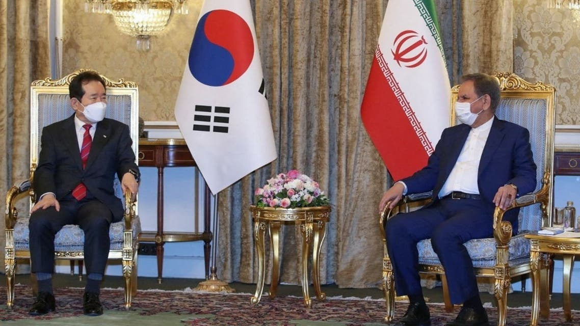 A handout picture provided by the official website of Iran's Vice President on April 11, 2021 shows Vice-President Eshaq Jahangiri (R) meeting with South Korea's Prime Minister Chung Sye-kyun in Tehran. (AFP)