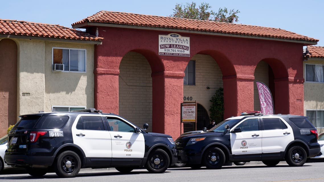 Los Angeles Police investigate the scene of a crime at the Royal Villa apartments complex in Reseda, Calif., Saturday, April 10, 2021. (AP)