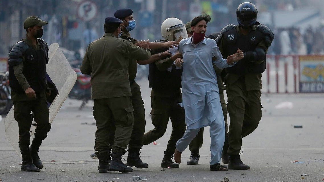 Police officers take into custody a supporter of Tehreek-e-Labiak Pakistan, a radical Islamist political party, at a protest against the arrest of their leader Saad Rizvi, in Lahore, Pakistan, Monday, April 12, 2021. (AP)