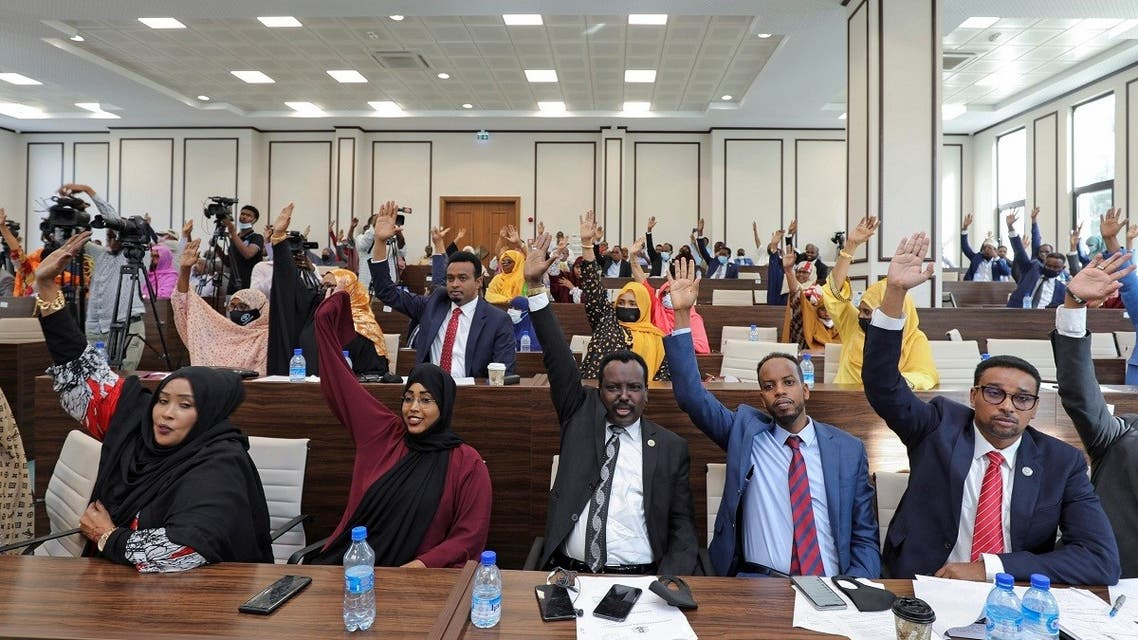 Somali legislators of the lower house of parliament raise their hands to vote to extend President Mohamed Abdullahi Mohamed's term for another two years, April 12, 2021. (Reuters)