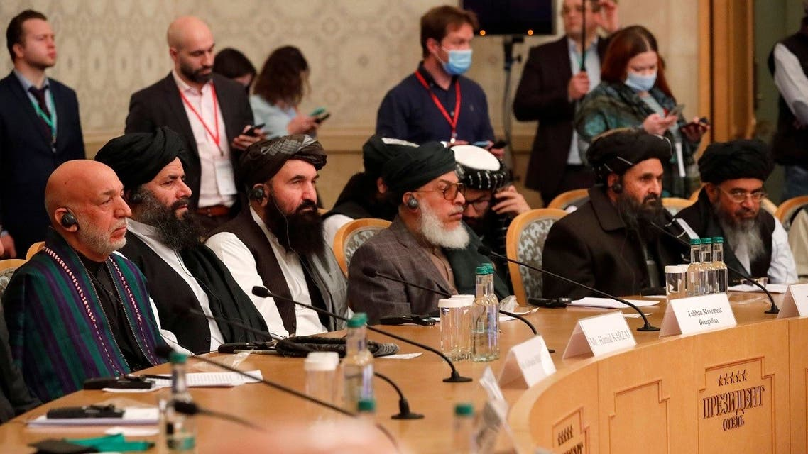 Officials, including Afghan former President Hamid Karzai and the Taliban's deputy leader and negotiator Mullah Abdul Ghani Baradar, attend the Afghan peace conference in Moscow, March 18, 2021. (Reuters)