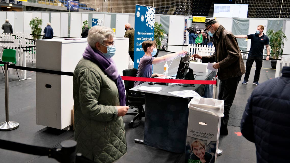 People register to be vaccinated against Covid-19 at the vaccination site in Arena Nord in Frederikshavn, Jutland, Denmark, on April 12, 2021, amid the novel coronavirus / COVID-19 pandemic. (File photo: AFP)