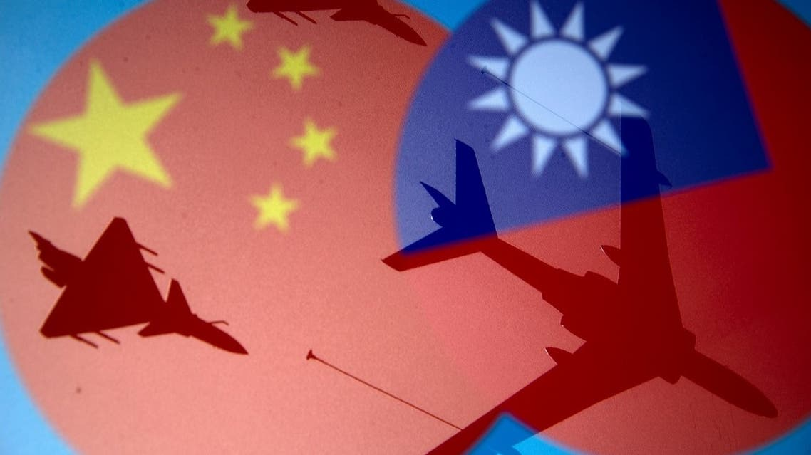 Chinese and Taiwanese national flags are displayed alongside military airplanes in this illustration taken on April 9, 2021. (Reuters)