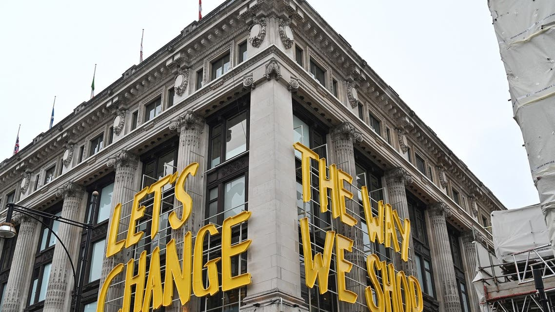 A sign reading Let's change the way we shop is pictured outside the Selfridges department store on Oxford Street in central London as coronavirus restrictions are eased after England's third national lockdown on April 12, 2021. (File photo: AFP)