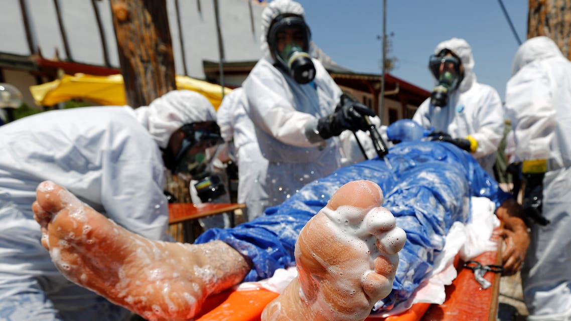 Syrian medical staff take part in a training exercise to learn how to treat victims of chemical weapons attacks, in a course organized by the World Health Organisation (WHO) in Gaziantep, Turkey, July 20, 2017. (Reuters)
