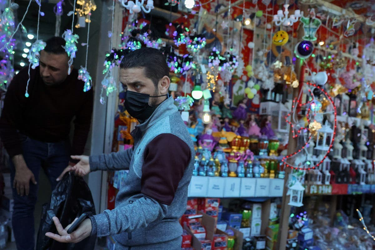 A Palestinian man gestures outside a shop displaying Ramadan decorations, ahead of the holy fasting month of Ramadan, in Gaza City . (Reuters)