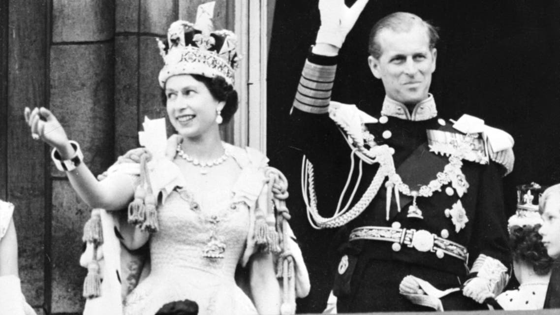 Britain's Queen Elizabeth II (L) accompanied by Britain's Prince Philip, Duke of Edinburgh (R) waves to the crowd, June 2, 1953 after being crowned at Westminter Abbey in London. Elizabeth married the Duke of Edinburgh on the 20th of November 1947 and was proclaimed Queen in 1952 at age 25. Her coronation was the first worldwide televised event. afp