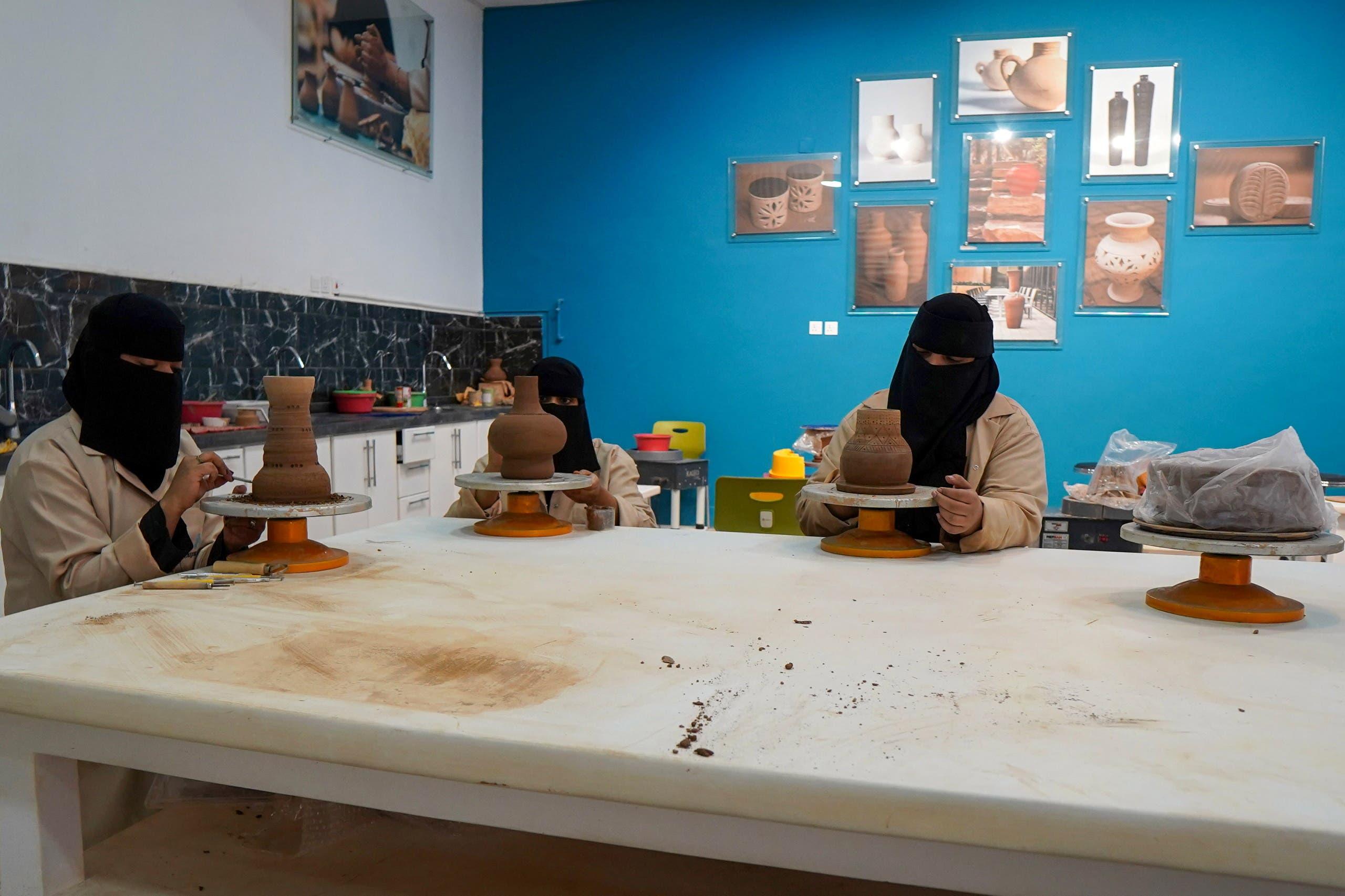 Saudi women work on pots in a workshop in AlUla, Saudi Arabia, April 8, 2021. Picture taken April 8, 2021. (Reuters)