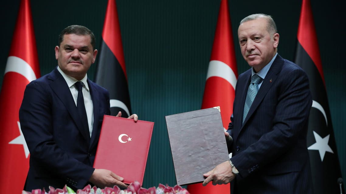 Turkish President Tayyip Erdogan and Libyan Prime Minister Abdulhamid?Dbeibeh pose during a signing ceremony in Ankara, Turkey April 12, 2021. (Reuters)