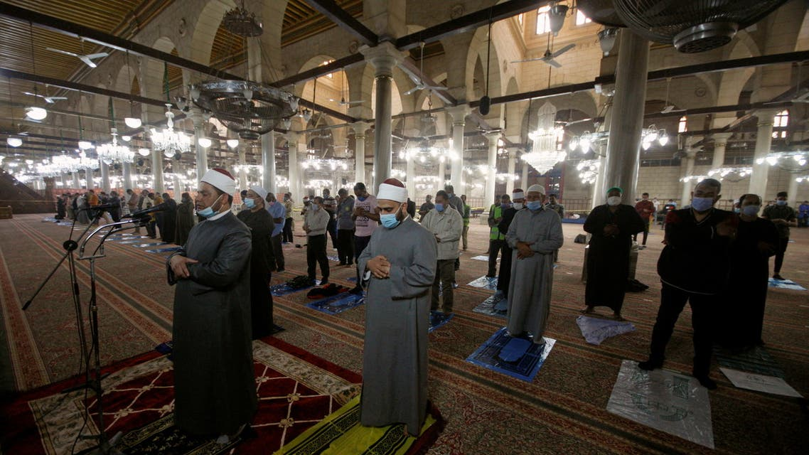 People pray at Al-Hussein mosque as it is being prepared for prayers during the holy month of Ramadan, following the outbreak of the coronavirus disease (COVID-19), in Cairo, Egypt, April 7, 2021. (Reuters)
