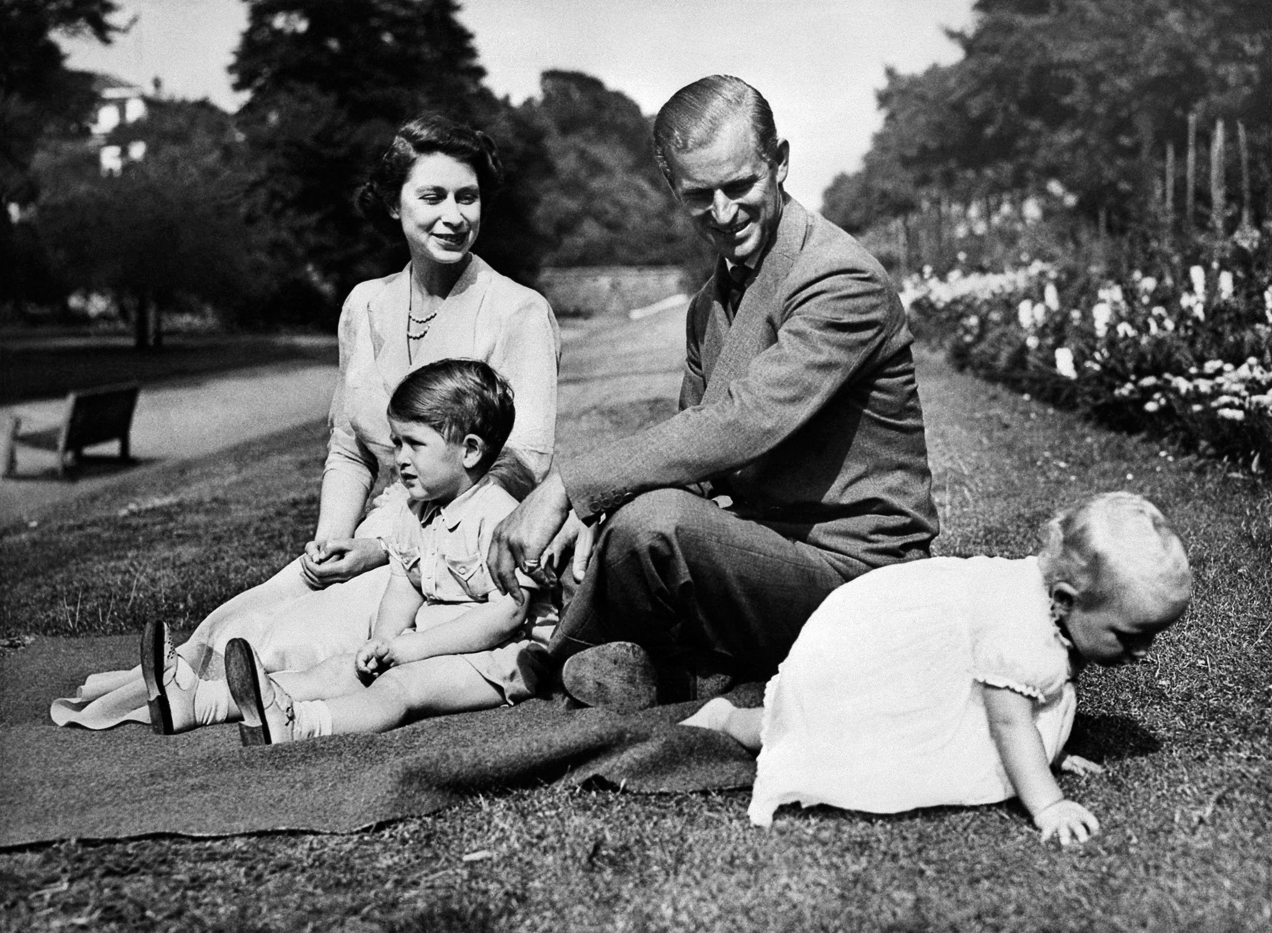 Undated picture showing the Royal British couple, Queen Elizabeth II, and her husband Philip, Duke of Edinburgh, with their two children, Charles, Prince of Wales (L) and Princess Anne (R). (AFP)