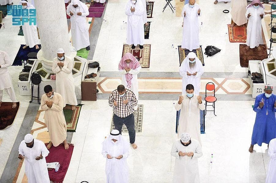 Muslims perform socially-distanced Taraweeh prayers in the Prophet's Mosque in Medina ahead of the holy month Ramadan. (SPA)