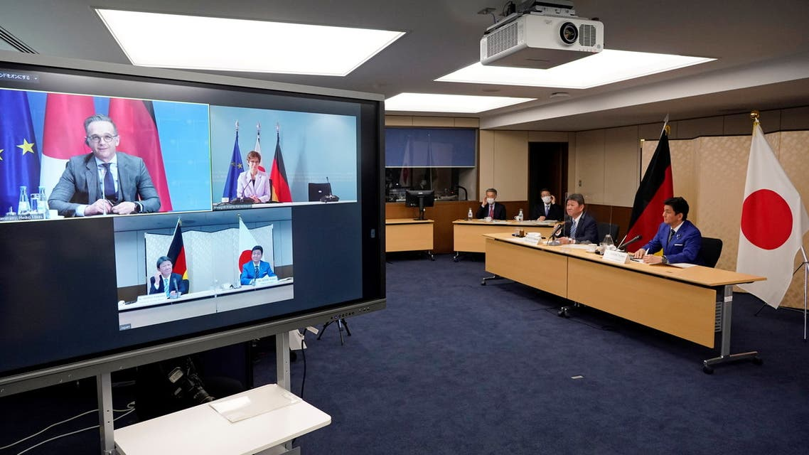 Japan's Foreign Minister Toshimitsu Motegi (2-R) and Defence Minister Nobuo Kishi (R) attend a video conference with German Foreign Minister Heiko Maas (top L, on screen) and Defence Minister Annegret Kramp-Karrenbauer (top R, on screen) at the Foreign Ministry in Tokyo, Japan, April 13, 2021. Both parties held their Foreign and Defense Ministerial Meeting '2+2' to strengthen their cooperation. (Reuters)