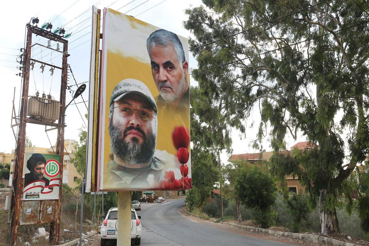 A poster depicting assassinated Hezbollah military commander Imad Mughniyeh and Iran's Quds Force top commander Qassem Soleimani in Ain Qana, Lebanon, Sept. 22, 2020. (Reuters)