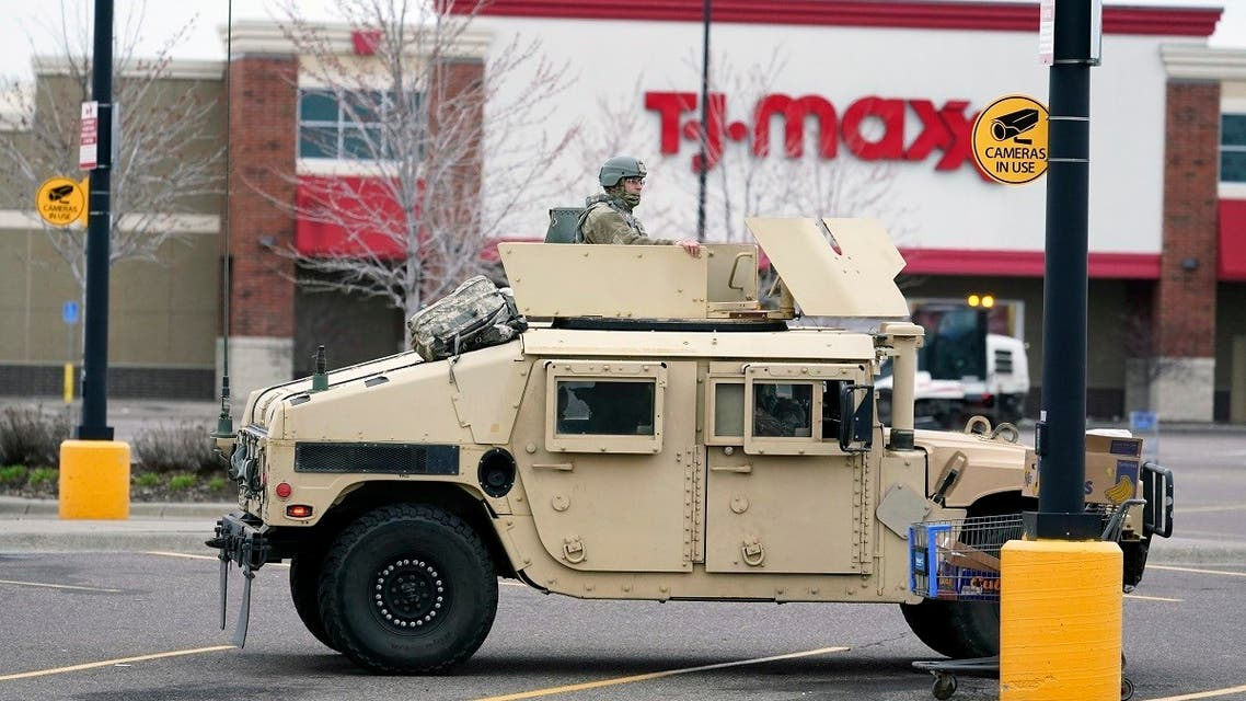A National Guard soldier maintains watch at a shopping center in Brooklyn Center, Minneapolis, April 12, 2021. (Reuters)