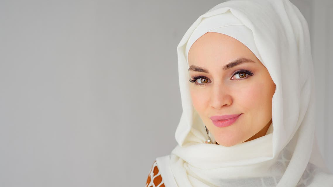 Portrait of muslim arabian woman wearing hijab, looking at camera stock photo