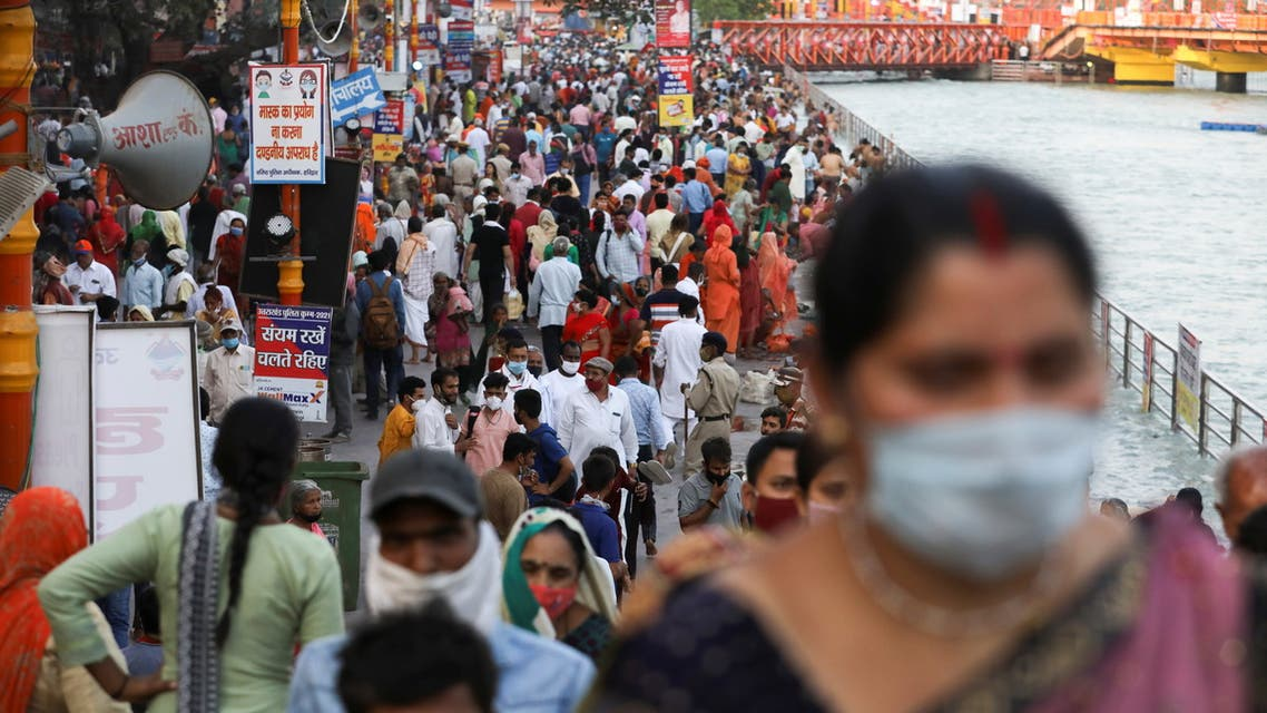 Devotees are seen on the banks of the Ganges river during Kumbh Mela, or the Pitcher Festival, amidst the spread of the coronavirus disease (COVID-19), in Haridwar, India, April 12, 2021. (Reuters)