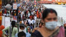 India's new coronavirus infections hit record as Hindu devotees immerse in Ganges