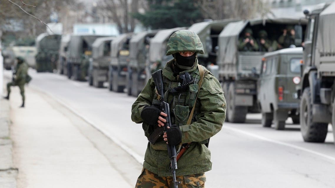 Armed servicemen wait in Russian army vehicles outside a Ukranian border guard post in the Crimean town of Balaclava. (File Photo: Reuters)